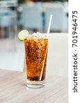 iced soda drinking glass on... | Shutterstock . vector #701946475
