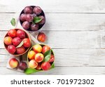 fresh ripe peaches on wooden... | Shutterstock . vector #701972302