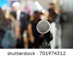 close up of microphone in event | Shutterstock . vector #701974312