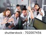 guys and girls having fun in... | Shutterstock . vector #702007456