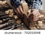 Carpenter Working In His...