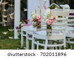 chairs decorated with vases of... | Shutterstock . vector #702011896
