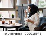 Arab Women In Hijab Holding An...
