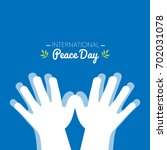 international peace day with... | Shutterstock .eps vector #702031078