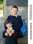 boy and girl on a front of... | Shutterstock . vector #702034132