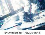 smart businessman working with... | Shutterstock . vector #702064546