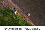 summer love  couple sitting on...   Shutterstock . vector #702068662