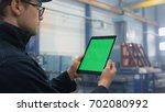 footage of a tablet with green... | Shutterstock . vector #702080992