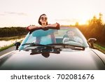 traveling by car   couple in... | Shutterstock . vector #702081676