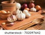 garlic. sliced garlic  garlic...   Shutterstock . vector #702097642