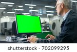 senior engineer in glasses is... | Shutterstock . vector #702099295