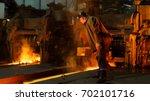 heavy industry worker working... | Shutterstock . vector #702101716