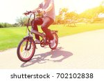 a man riding on electric... | Shutterstock . vector #702102838