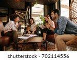 group of businesspeople having... | Shutterstock . vector #702114556
