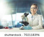 woman chemistry. | Shutterstock . vector #702118396