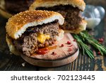 big burger with cheddar cheese   Shutterstock . vector #702123445