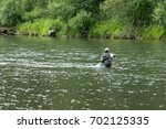fly fisherman flyfishing in... | Shutterstock . vector #702125335