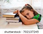 girl doing homework. the child... | Shutterstock . vector #702137245