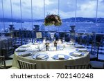 wedding guest dining table... | Shutterstock . vector #702140248