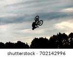 jumping on a bike  | Shutterstock . vector #702142996