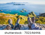 feet of people hikers relaxing... | Shutterstock . vector #702146446