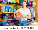 beautiful girl with disposable... | Shutterstock . vector #702160102