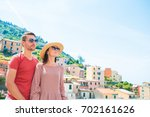 tourists looking at scenic view ... | Shutterstock . vector #702161626
