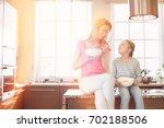 happy mother and daughter... | Shutterstock . vector #702188506