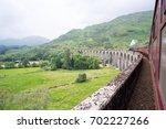jacobite steam train locomotive ... | Shutterstock . vector #702227266