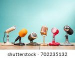 retro old microphones for press ... | Shutterstock . vector #702235132