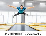 A Young Fit Happy Man Jumping...