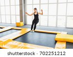 young woman amateur acrobatic... | Shutterstock . vector #702251212
