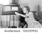 woman changing radio channel | Shutterstock . vector #702255952