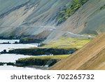 Small photo of Iceland, typical coastline with abrupt shores, fjords, mountains and road.