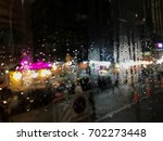rain on glass  | Shutterstock . vector #702273448