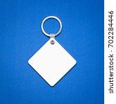 white key ring on blue... | Shutterstock . vector #702284446