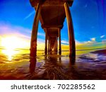 low angle view of pier in sea... | Shutterstock . vector #702285562