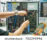 technicians are repairing... | Shutterstock . vector #702295996