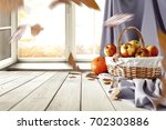 autumn window with wooden table ... | Shutterstock . vector #702303886