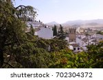landscape of the white village... | Shutterstock . vector #702304372