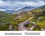 hiking in glen torridon  north... | Shutterstock . vector #702322642