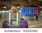close up man hand touching...   Shutterstock . vector #702333382