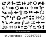 vector set of black arrows on a ... | Shutterstock .eps vector #702347338