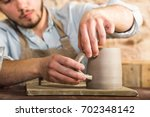 potter  stoneware  ceramics art ... | Shutterstock . vector #702348142
