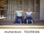 senior couple doing stretching