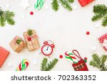 christmas gifts and ornaments... | Shutterstock . vector #702363352