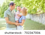 happy family smiling playing in ... | Shutterstock . vector #702367006