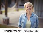 portrait of senior woman... | Shutterstock . vector #702369232
