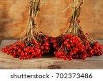 viburnum berries on the wooden... | Shutterstock . vector #702373486