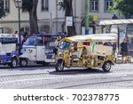 Small photo of LISBON, PORTUGAL, on June 22, 2017. Rat-tat goes on the city street to downtown
